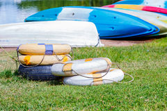 Lifebuoys and boats. For water sport Stock Photo