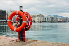 Lifebuoys on quay in Thessaloniki. Nikis Avenue in the background. Greece Royalty Free Stock Image