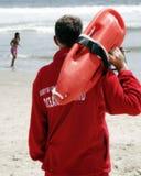 Lifegaurd on duty. Local lifeguard doing his job protecting fellow beachgoers Royalty Free Stock Photography