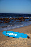Lifeguard. Blue lifeguard surf on a beach, rocks in water, waves Royalty Free Stock Images