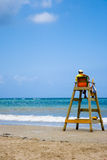 Lifeguard. Looking towards the sea sitting on his chair stock photo