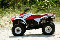 Lifeguard ATV. The Red and White ATV vehicle that the lifeguard at the beach uses royalty free stock image