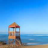 Lifeguard or baywatch wooden beach tower, cabin or hut. Lifeguard or baywatch wooden beach observation tower, cabin or hut. Long exposure photography. Italy royalty free stock image