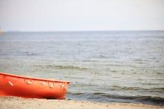 Lifeguard beach rescue equipment orange boat Stock Images