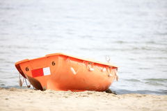Lifeguard beach rescue equipment orange boat Stock Photo