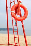 Lifeguard beach rescue equipment orange lifebuoy Stock Photos