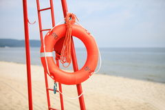 Lifeguard beach rescue equipment orange lifebuoy Stock Image
