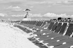 Lifeguard or beach rescue man. Great Stirrup Cay, Bahamas - January 8, 2016: lifeguard or beach rescue man on duty sits on tower chair and supervises safety of royalty free stock images