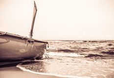 Lifeguard boat on the beach in sepia Stock Photo
