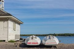 Lifeguard boat stored at beach by shack end of day Royalty Free Stock Photography