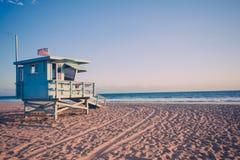 Lifeguard cabin on Santa Monica beach. In California on sunset, retro toned Royalty Free Stock Photos