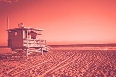 Lifeguard cabin on Santa Monica beach living coral toned stock photo
