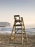 Lifeguard Chair. Lifeguard seat facing to sea in an empty beach. Photo taken with the early morning light Stock Photos