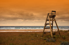Lifeguard chair. On a beach at sunset royalty free stock photography