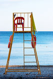 Lifeguard chair. Empty lifeguard chair on the beach with life buoys royalty free stock images