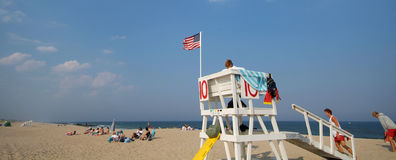 Lifeguard Chair. On beach with wide angle stock photography