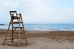 Lifeguard chair. Wooden lifeguard chair at an empty beach stock image