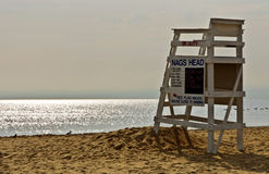 Lifeguard chair on beach. A lifeguard chair sits at the end of summer on a deserted Nags Heads beach in the Outer Banks of North Carolina stock photography