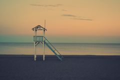Lifeguard chair on beach at dawn Royalty Free Stock Photography
