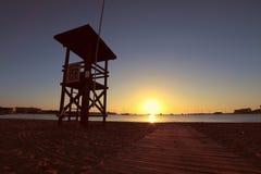 Lifeguard chair on beach at dawn