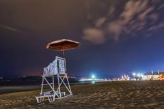 Lifeguard chair in a beach by night royalty free stock photography