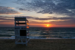 Lifeguard chair on beach at sunrise. A lifeguard chair sits on a deserted Nags Heads beach at sunrise in the Outer Banks of North Carolina royalty free stock photos