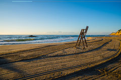 Lifeguard chair on empty beach. Sunrise with lifeguard chair on empty beach Royalty Free Stock Photography