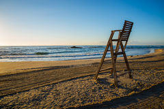 Lifeguard chair on empty beach. Sunrise with lifeguard chair on empty beach Stock Photography