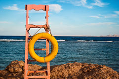 Lifeguard chair with lifebuoy Royalty Free Stock Photo