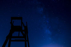 Lifeguard chair at night. With stars and milky way stock image