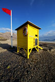 Lifeguard chair red flag in s  coastline and summer Royalty Free Stock Photos