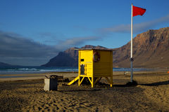 Lifeguard chair red flag in spain   coastline and summer Stock Image