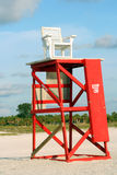 Lifeguard chair and tower. Lifeguard chair on top of red tower on sandy beach, Sand Key Park, Clearwater, Florida; U.S.A royalty free stock photo