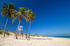 Lifeguard chair under palm trees on a paradise beach. Cuba, the Caribbean stock images
