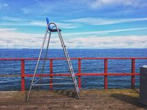 Lifeguard chair. At a wooden pier royalty free stock image