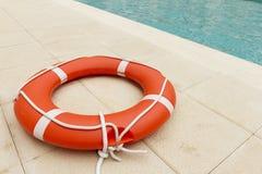 Lifeguard close to swimming pool Royalty Free Stock Image