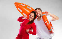 Lifeguard couple with rescue equipment Royalty Free Stock Images