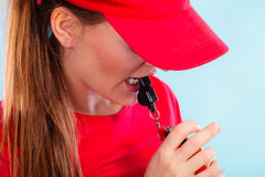 Lifeguard on duty blowing a whistle Royalty Free Stock Photos