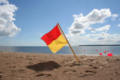 Lifeguard on duty flag Royalty Free Stock Photography