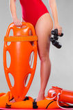 Lifeguard on duty holds binocular Royalty Free Stock Photography
