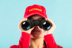 Lifeguard on duty looking through binocular Royalty Free Stock Images