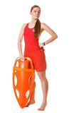 Lifeguard on duty with rescue buoy supervising. Stock Images