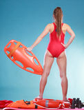 Lifeguard on duty with rescue buoy supervising. Royalty Free Stock Photos