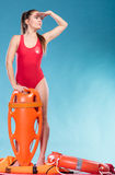 Lifeguard on duty with rescue buoy supervising. Royalty Free Stock Image