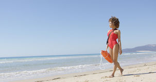 Lifeguard female with rescue float Stock Photos
