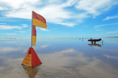 Lifeguard flag at Murawhai beach Royalty Free Stock Image
