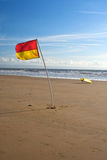 Lifeguard Flag and Surfboard Stock Photos