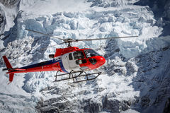 Lifeguard helicopter on Everest base camp in Nepal. Lifeguard helicopter in Nepal mountains Royalty Free Stock Photos