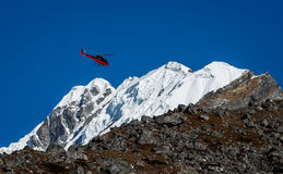 Lifeguard helicopter in Himalaya mountains in Nepal stock photography