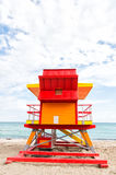 Lifeguard house red, orange color on sandy beach, Miami, Florida. Miami south beach. colorful lifeguard house or lifesaving art deco tower building red and Stock Photography
